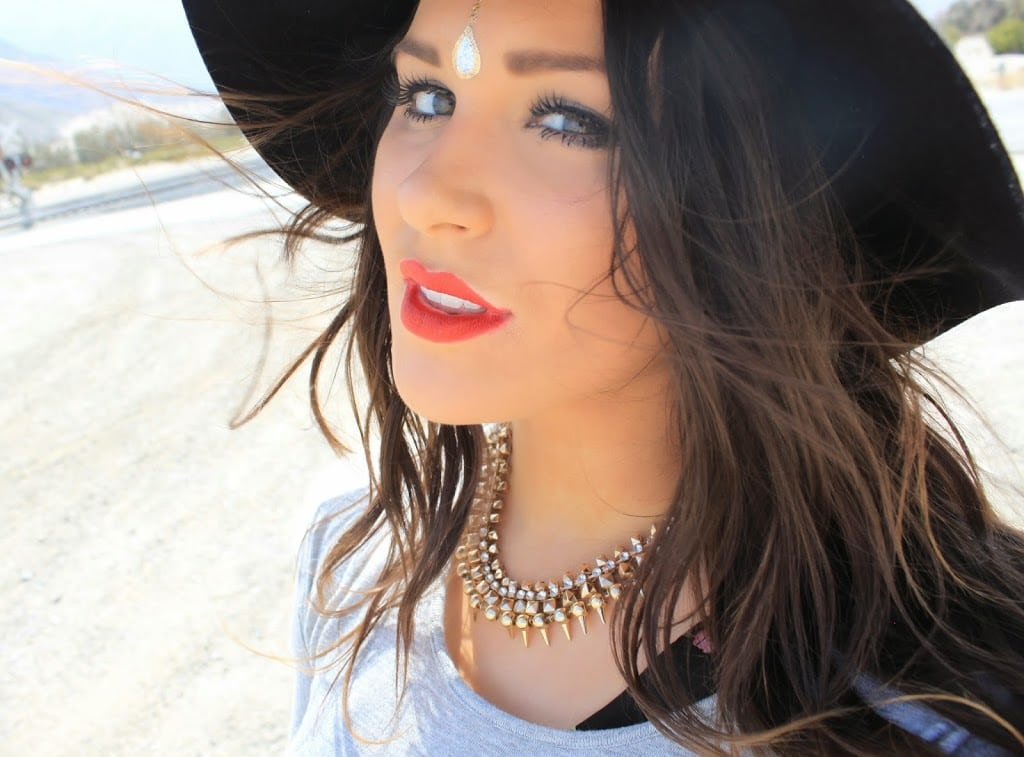 Fashion blogger Mash Elle shares how to wear Flash Tattoos on your face for music festivals Coachella