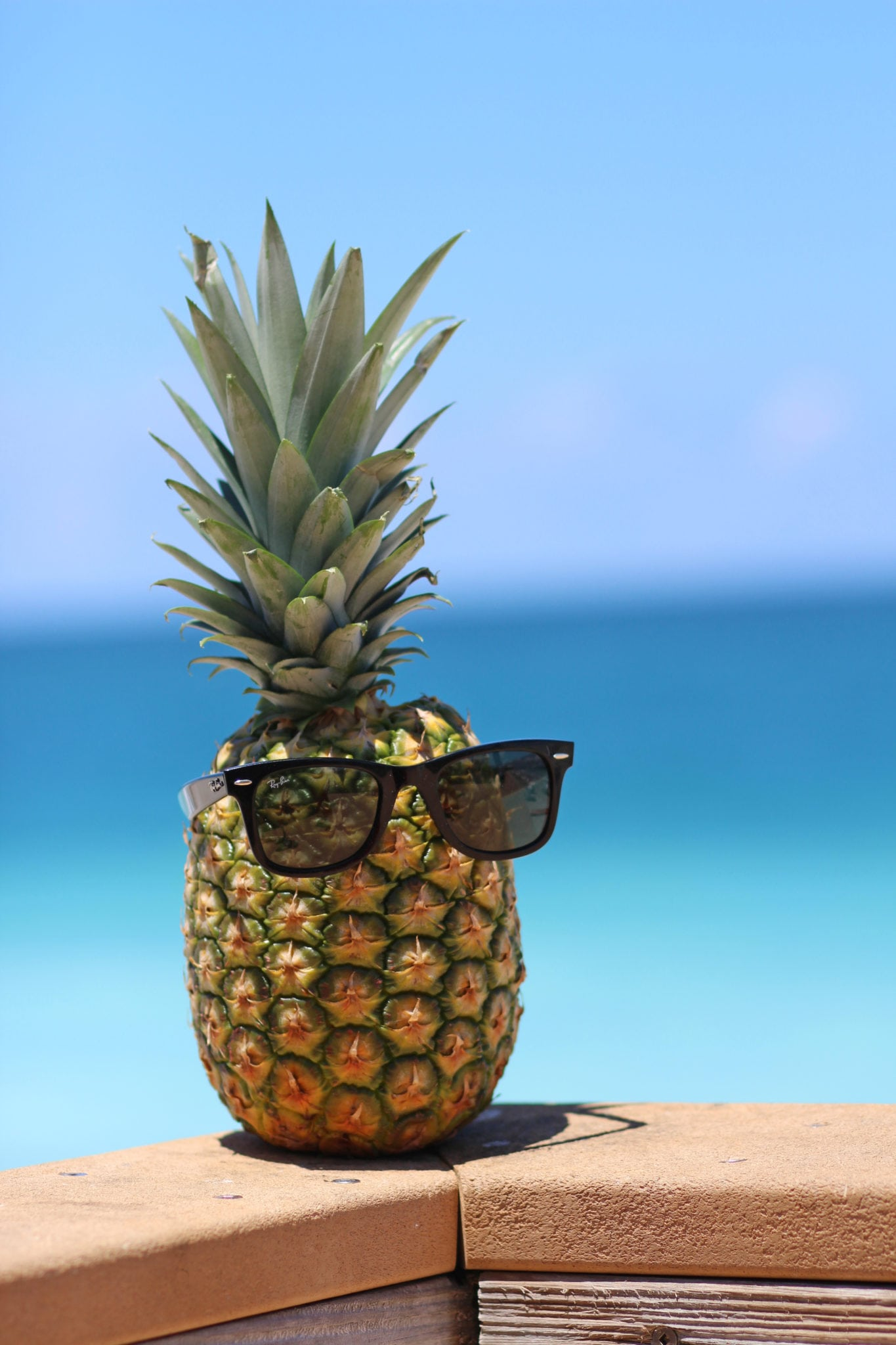 pineapple-at-the-beach-in-sunglasses