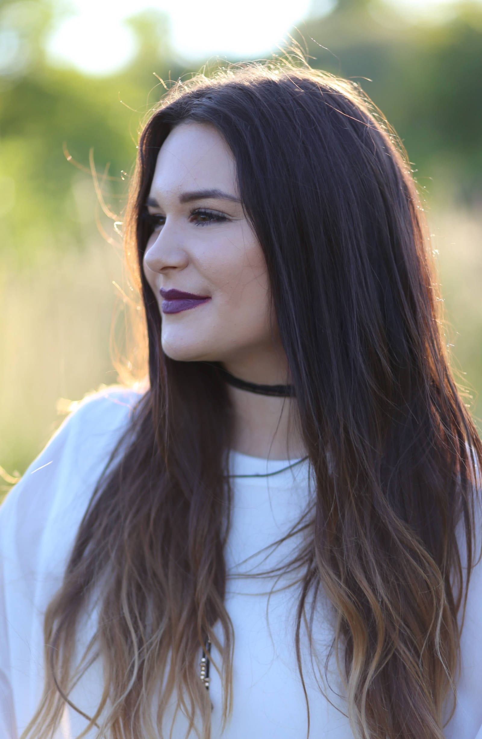 Beauty blogger Mash Elle models an easy and affordable Fall makeup look using a berry MAC lipstick