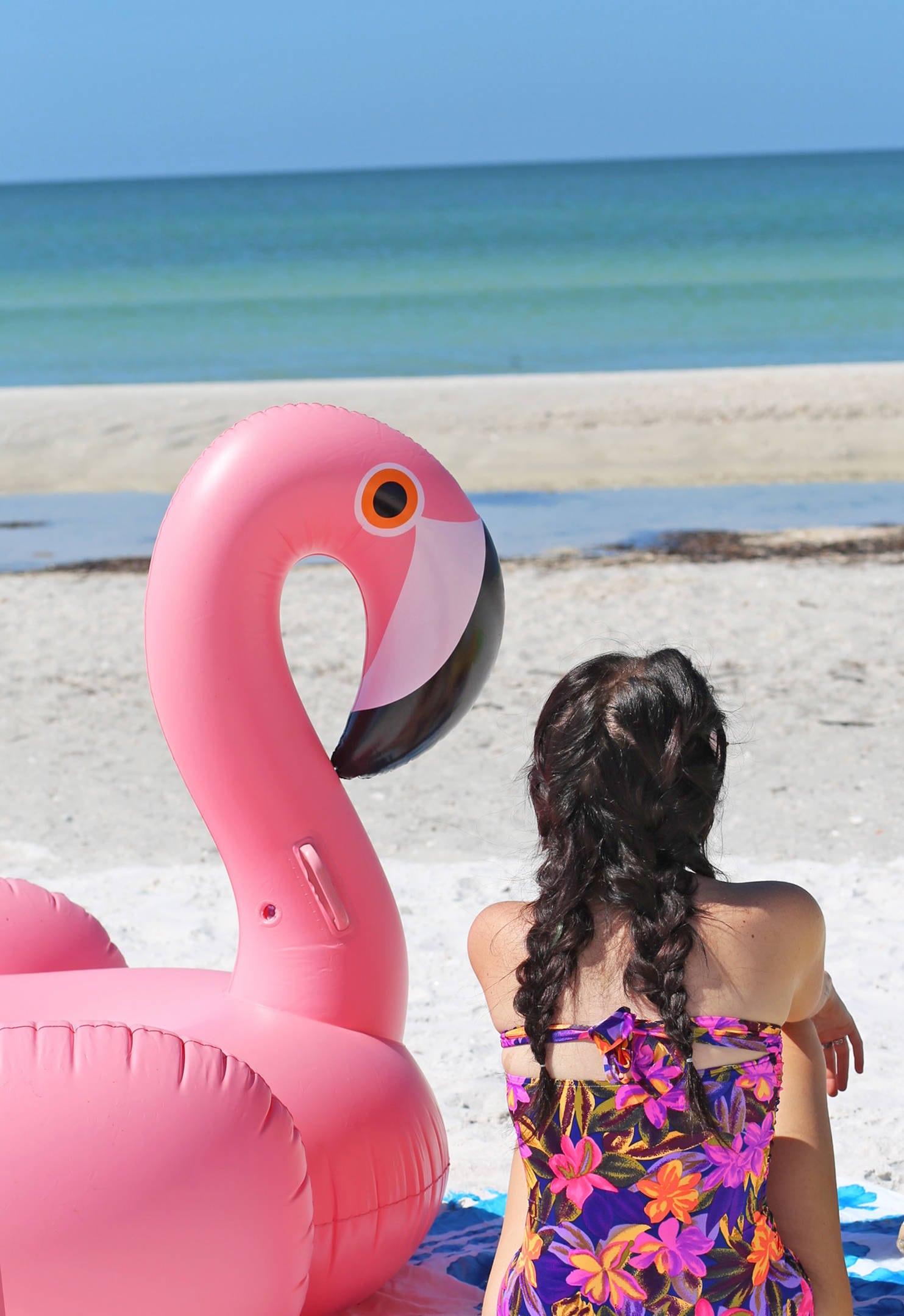 Mash Elle lifestyle blogger | St. pete beach | beauty blogger Mash Elle | black hat | plants | beach house | one piece flamingo float