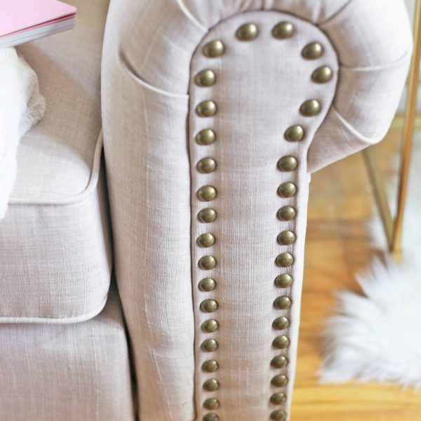 Fashion and lifestyle blogger Mash Elle styles an affordable cream tufted loveseat sofa from Kohls home office look