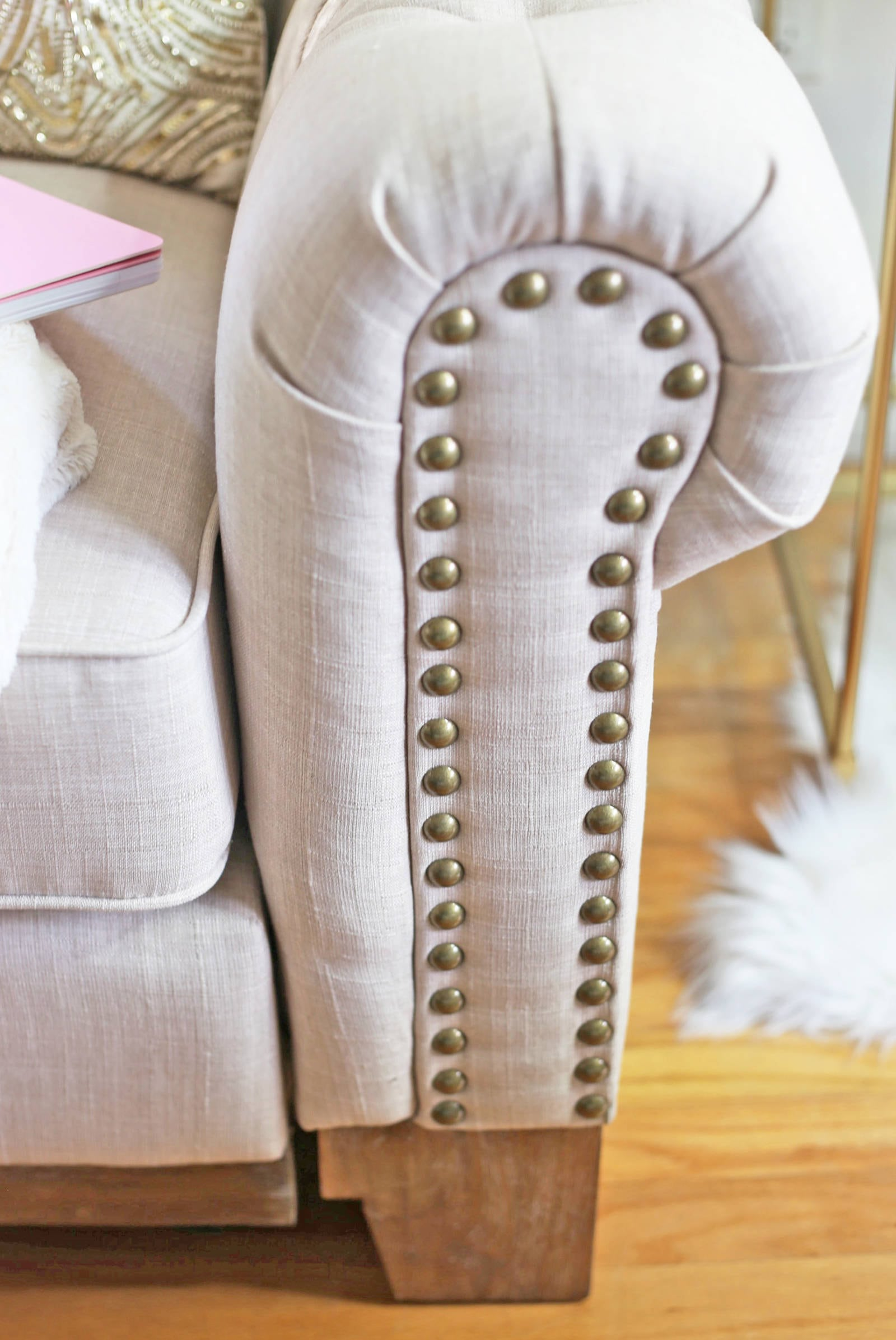 Blogger Mash Elle styles an affordable cream tufted sofa with gold details from Kohls home office look
