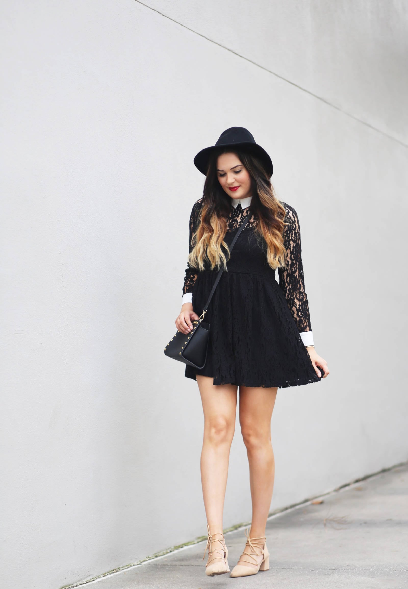 Fashion blogger Michelle Kehoe of Mash Elle shares a lacy little black dress Valentine's Day date outfit including a black lace Forever 21 dress!