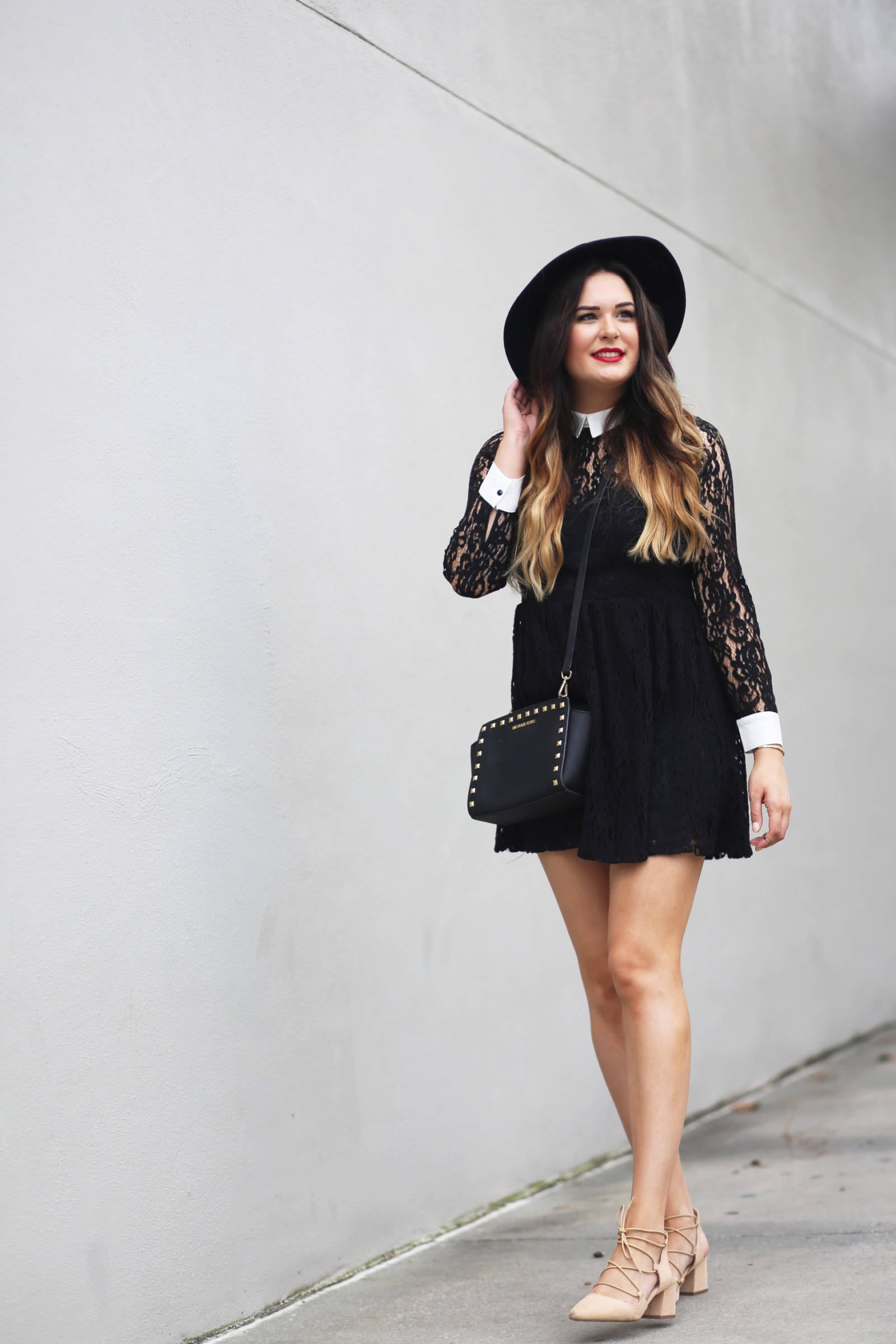 Fashion blogger Mash Elle styes a dressy date outfit complete with a Forever 21 black lace dress, Forever 21 pink blush lace up shoes, Michael Kors stud purse, Forever 21 black wide rim hat and Daniel Wellington rose gold bracelet.