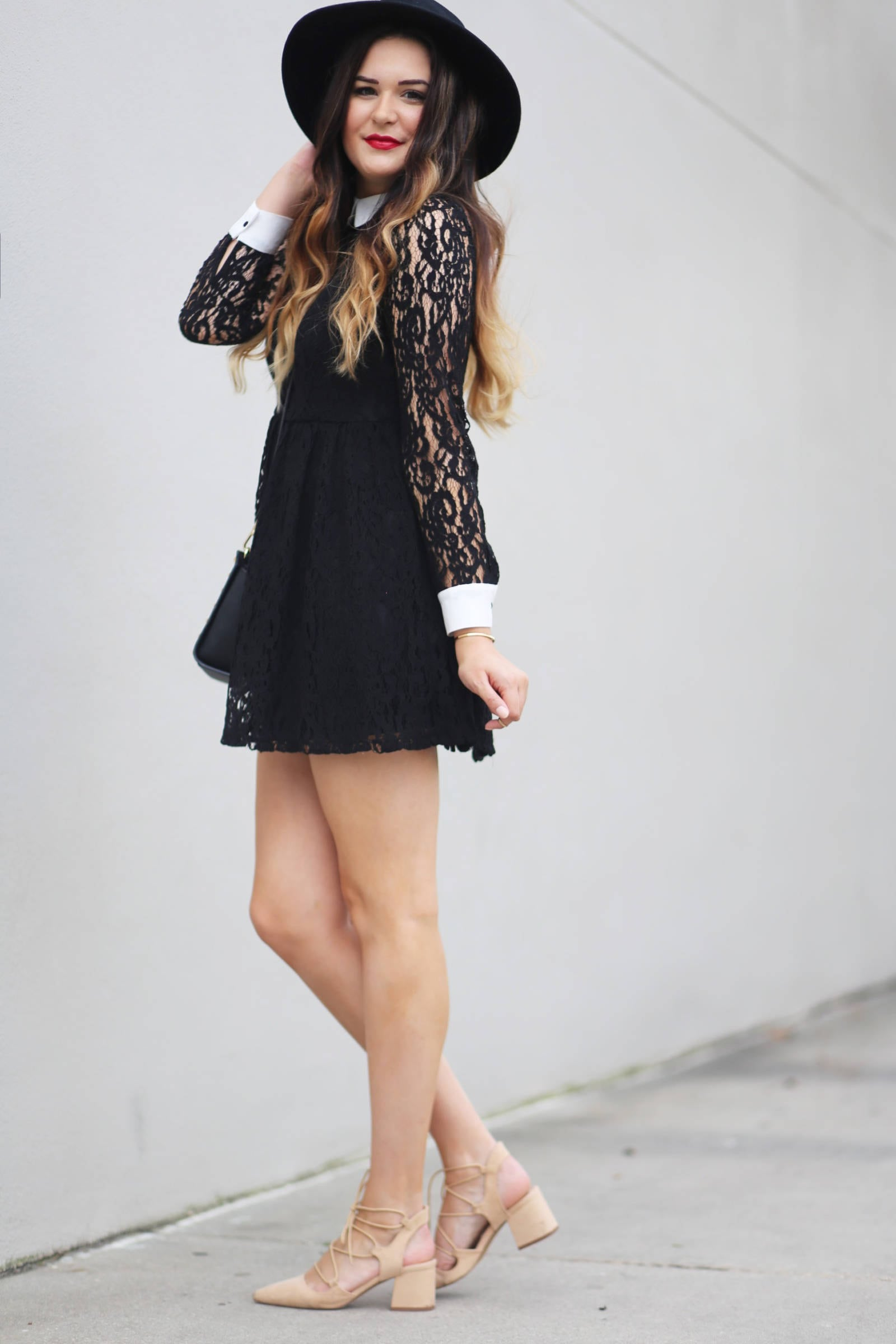 Fashion blogger Mash Elle styles a black lace dress and pink lace up shoes from Forever 21