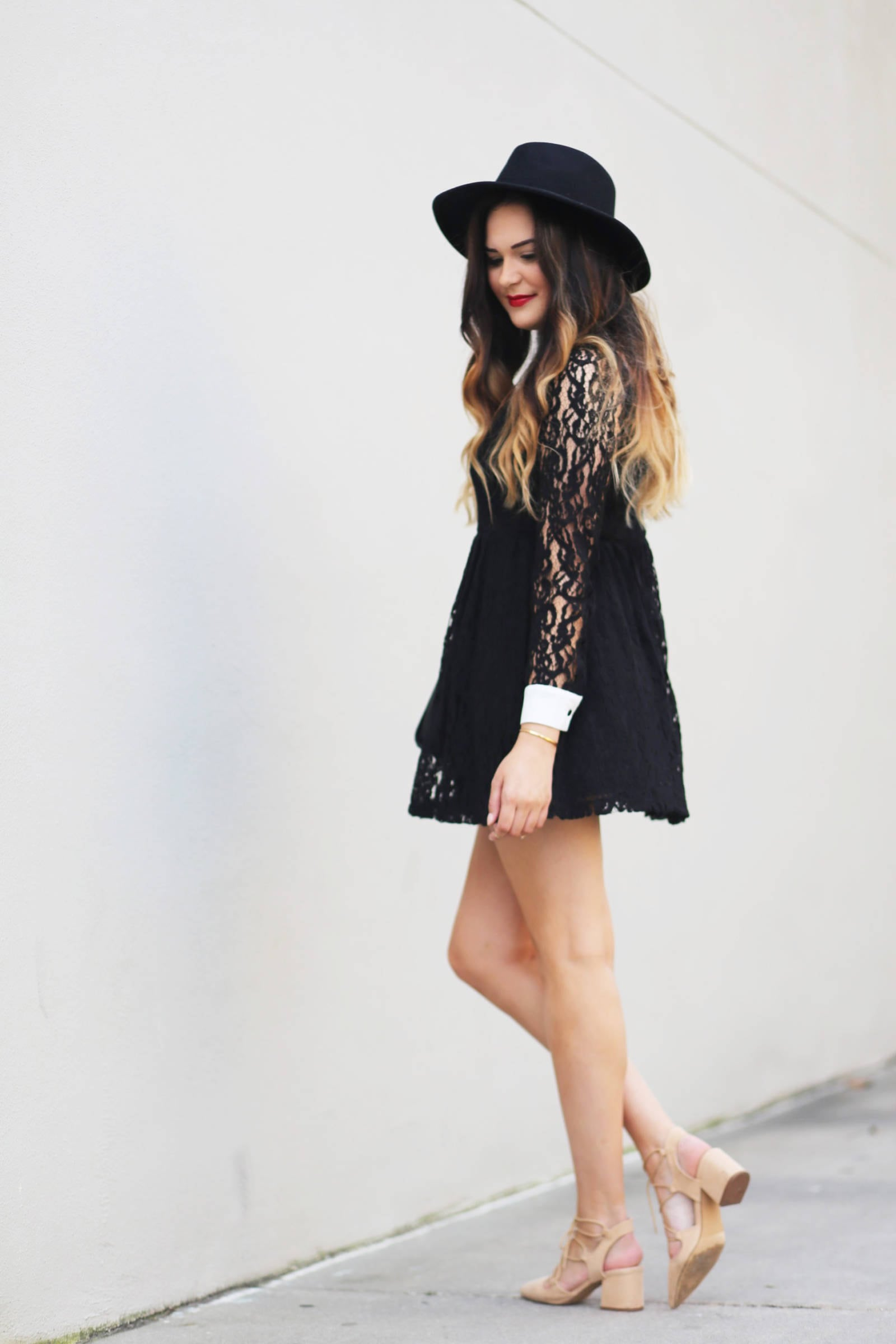 Fashion blogger Mash Elle shares a black lace dress for a day or night date. Forever 21 dress, Michael Kors purse, Elizabeth Arden lipstick, Daniel Wellington bracelet