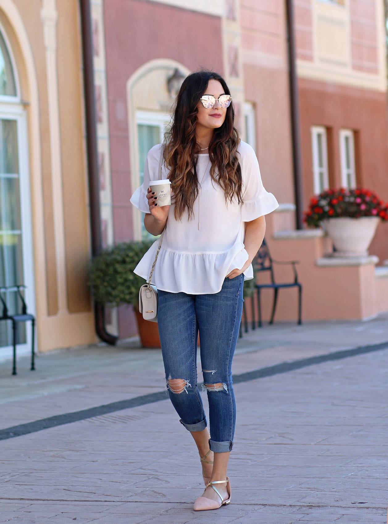 Fashion blogger Mash Elle shares a casual spring look | white ruffle shirt | Nordstrom, Express | ripped skinny jeans | comfortable Forever 21 flats.