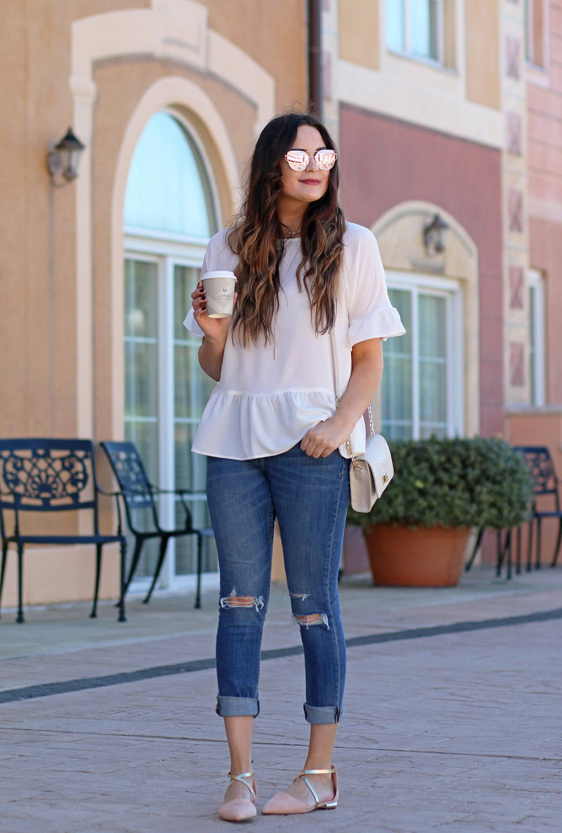 Fashion blogger Mash Elle shares a casual spring look | white ruffle shirt | Nordstrom, Express | ripped skinny jeans | comfortable Forever 21 flats | Loews Portofino Bay in Universal Studios, Orlando Florida
