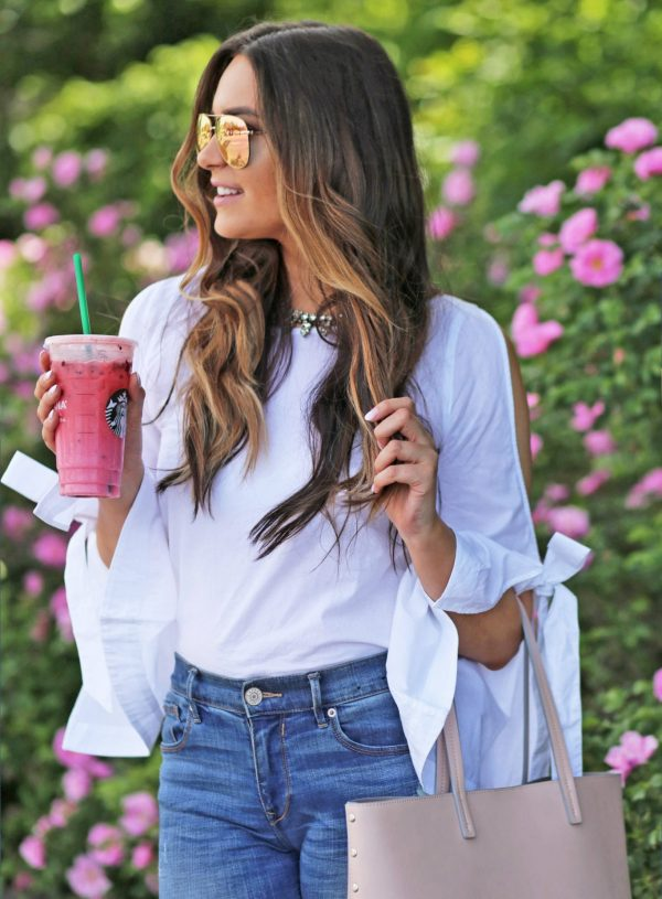 bow accent top white blue jeans nude heels sunglasses flowers blush purse Mash Elle beauty blogger summer fashion starbucks berry drink