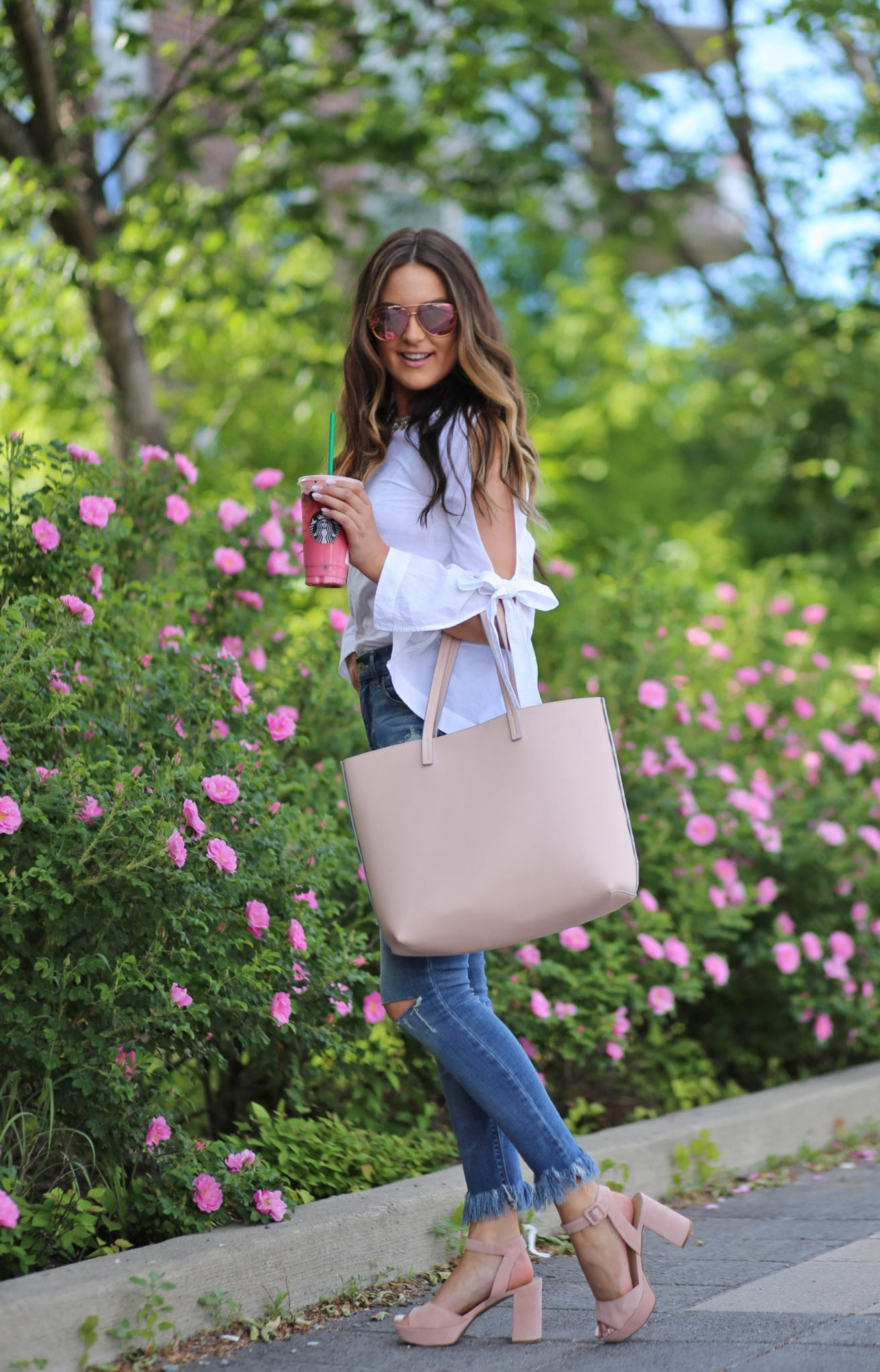 bow accent top  white   blue jeans   nude heels   sunglasses  flowers   blush purse   Mash Elle beauty blogger   summer fashion