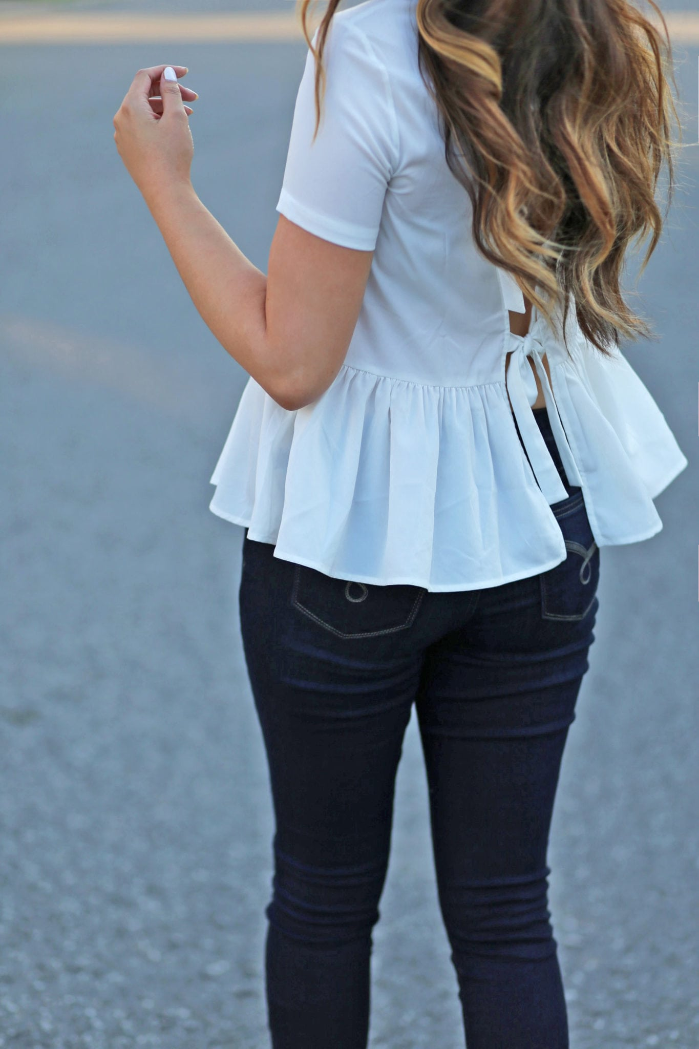 casual fall date outfit | open back peplum white shirt | tan taupe sweater | jeans | star boots | beauty blogger Mash Elle