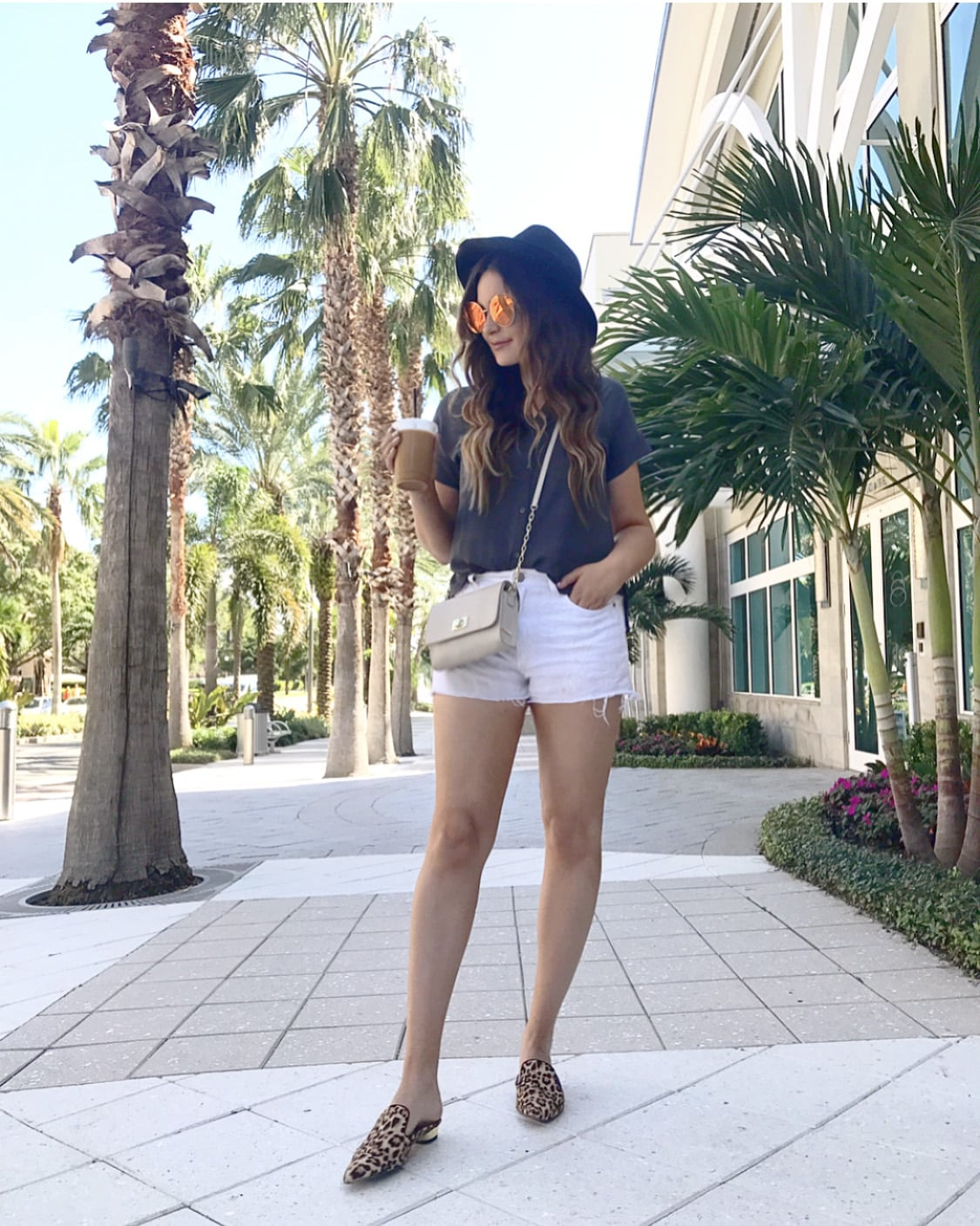 girls trip | st. petersburg florida |beauty blogger Mash Elle | florida | road trip | sunshine state round sunglasses hat white shorts