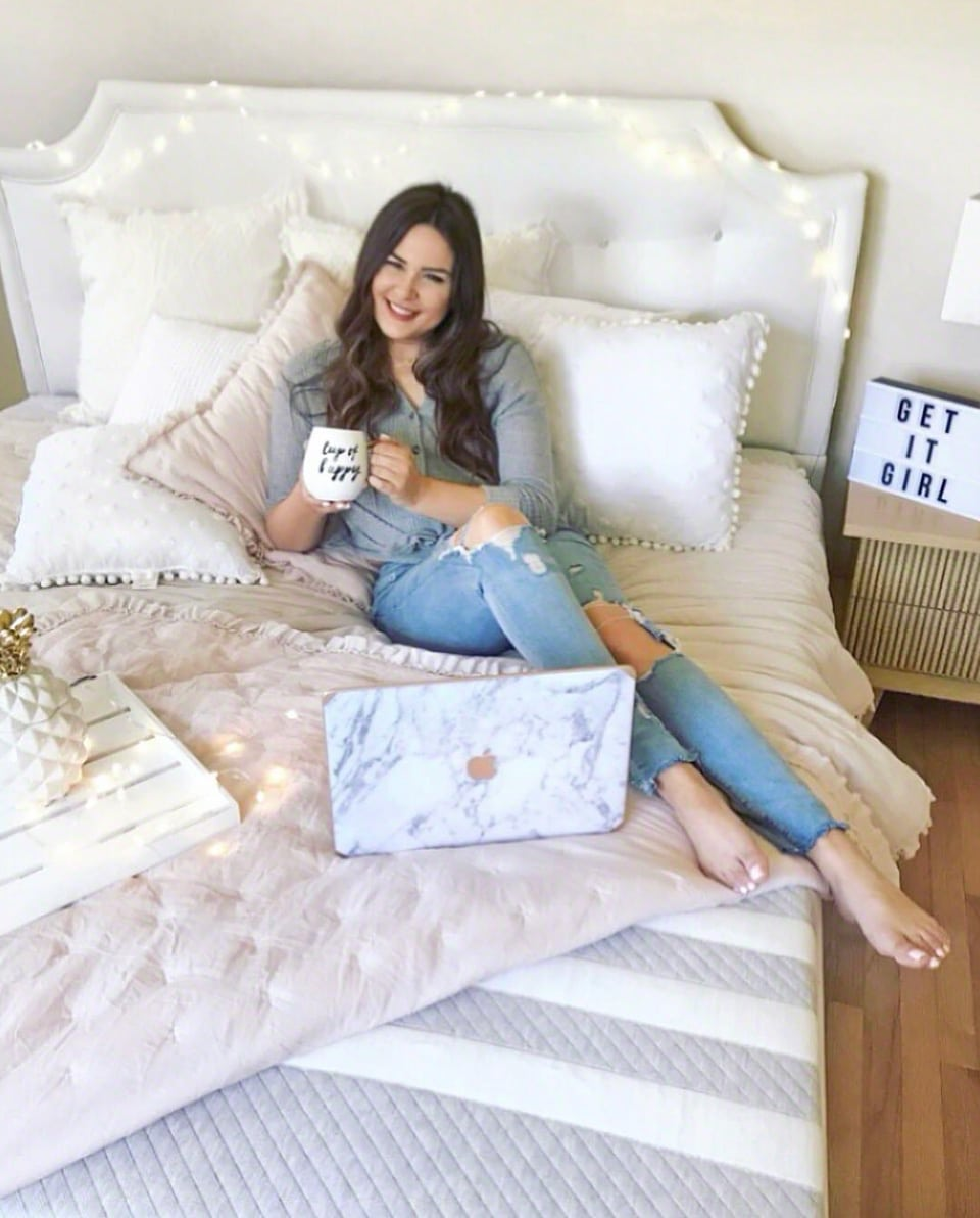 shop my instagram roundup styles Mash Elle sitting on bed with coffee