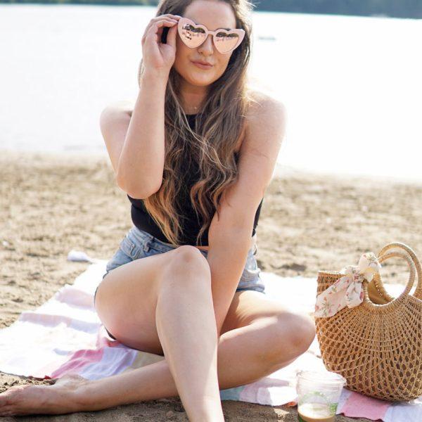 Mash Elle summer beach topknot hair style idea heart sunglasses black crop top jean shorts